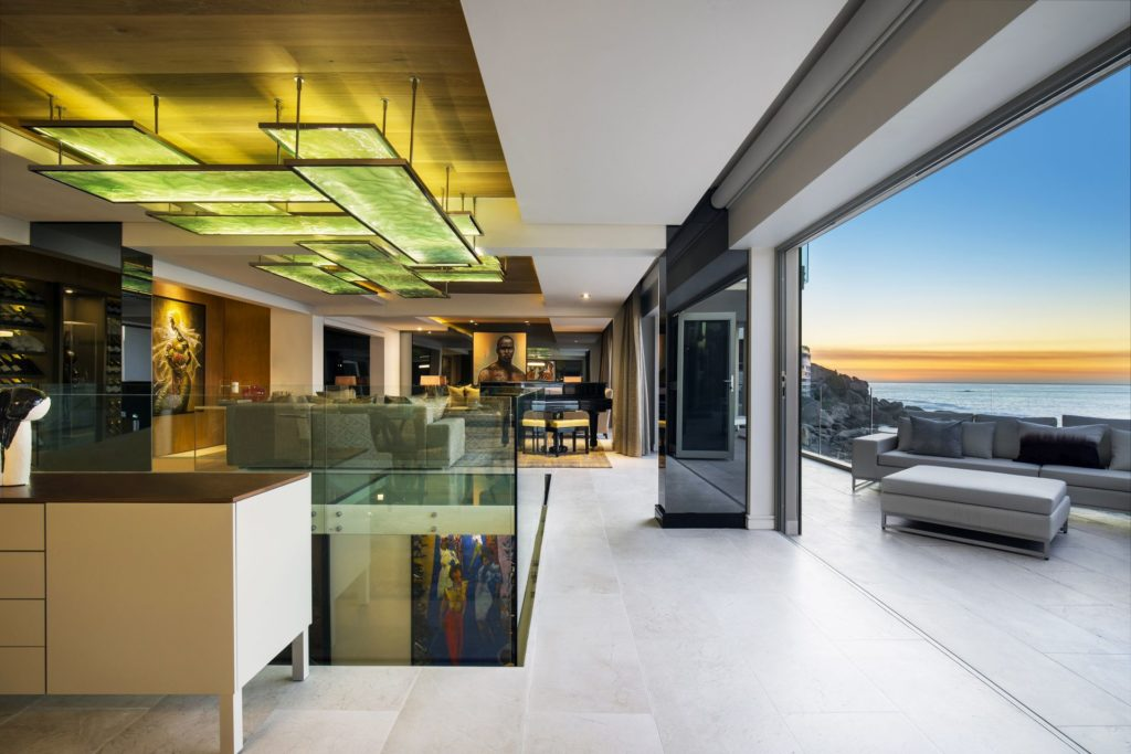 Apartment residential designs cliffside cape town love that design while the internal spaces are kept decidedly simple and elegant materials and textures such as satin brass limed oak stainless steel marble and mirror malvernweather Gallery